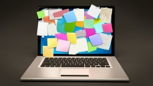 Laptop screen covered in post-it notes