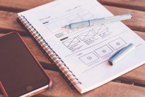 Web design sketched on notebook templating