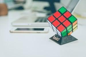 Rubiks cube near laptop
